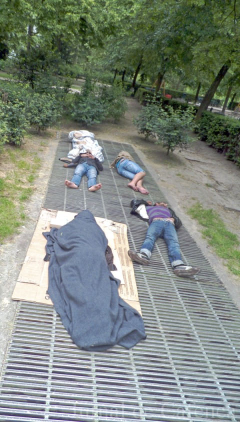 Homeless sleeping in the park in Central Brussels