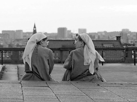 Two nuns resting at Pl. Poelaert, Brussels